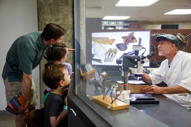 Photograph of people looking at the Tar Pits Fossil Lab