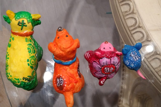 Decorated on the back of each animal is their Chinese character.
