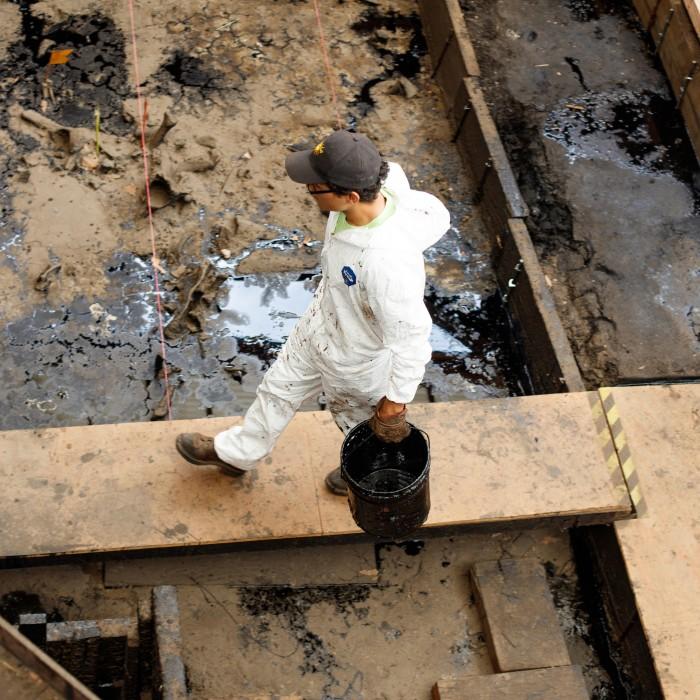 tar pits excavator walking in tar pit