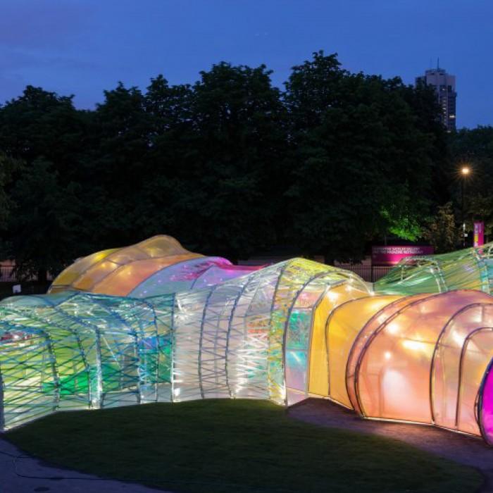 serpentine pavilion lit up at night