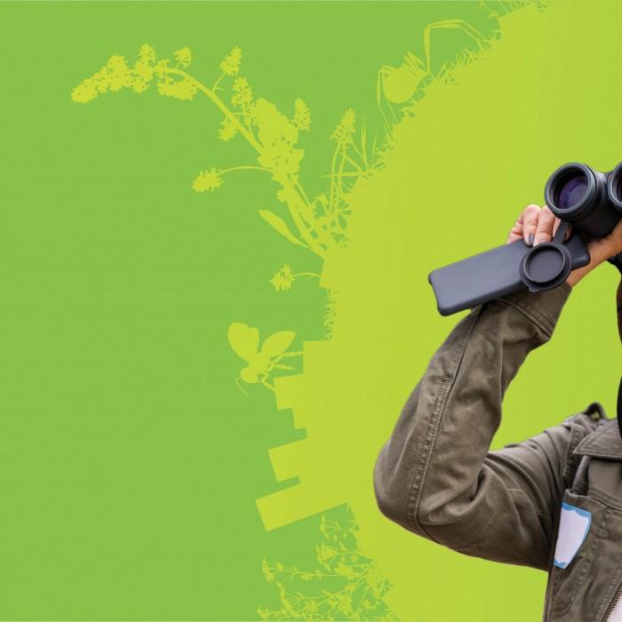 Woman using binoculars to observe nature