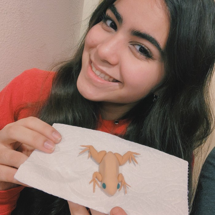 Kiana poses with her model frog