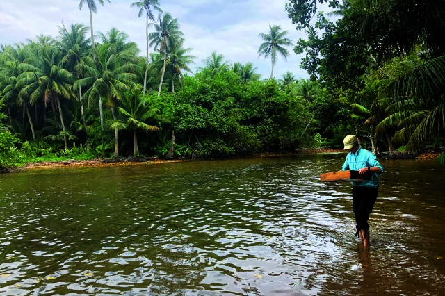 Amy Gusick doing field research in Micronesia