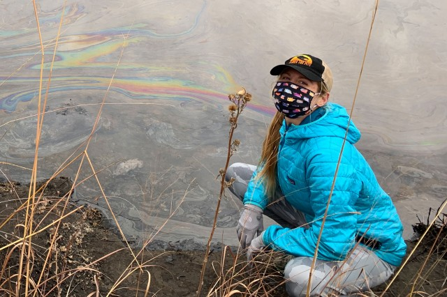 Researchers at the edge of a tar pit in Oklahoma