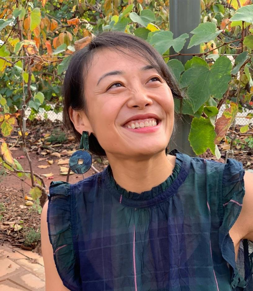 Jane Li smiling, in Nature Gardens at NHM