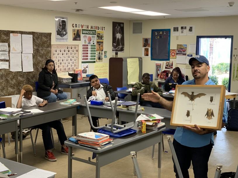 Miguel Ordeñana holds up a box of bat specimens at BALA