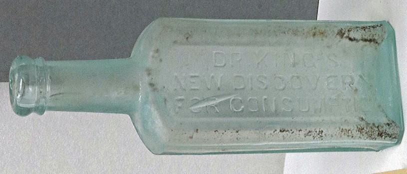 green glass medicine bottle