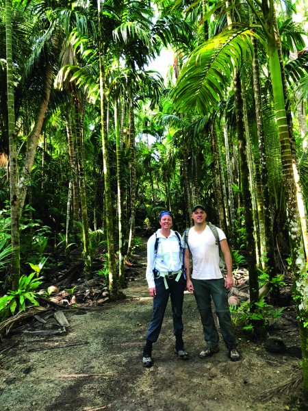 Amy Gusick with her colleague, Matthew Napolitano, surveying in the jungle on Yap