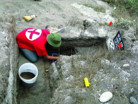 Amy Gusick excavating on near coast on Santa Cruz Island